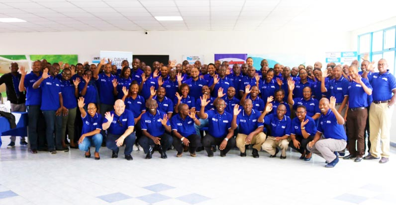 Participants are pictured with Group CEO David Gatende and other executives at the Branch Manager's Conference.